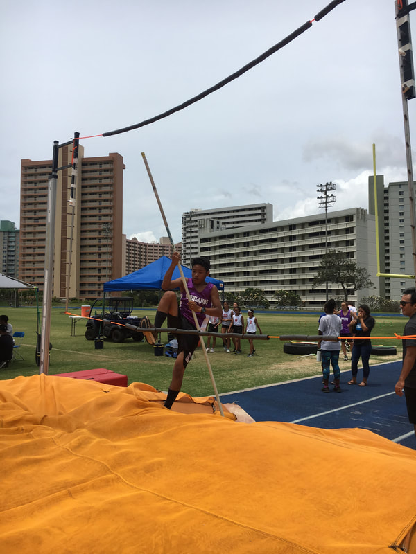Student jumping the pole vault.