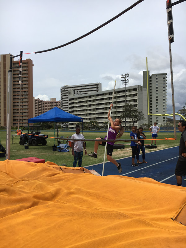 Another student jumping the pole vault.