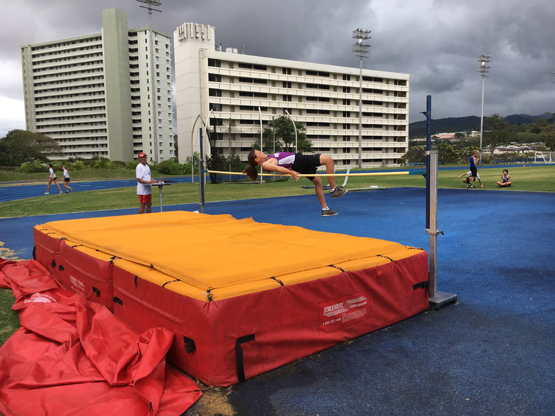 Student jumping high jump.